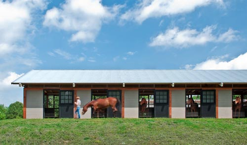 This Shedrow Style Barn Uses Light Colored Reflective Roofing Recycled Content Concrete Blocks And Is Naturally Lit Ventilated